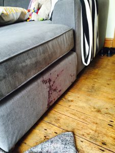 before red white stain was removed from grey sofa